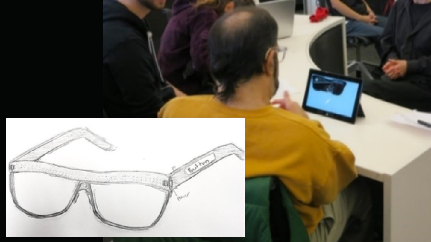 A computing student conducting a test with prototype glasses.