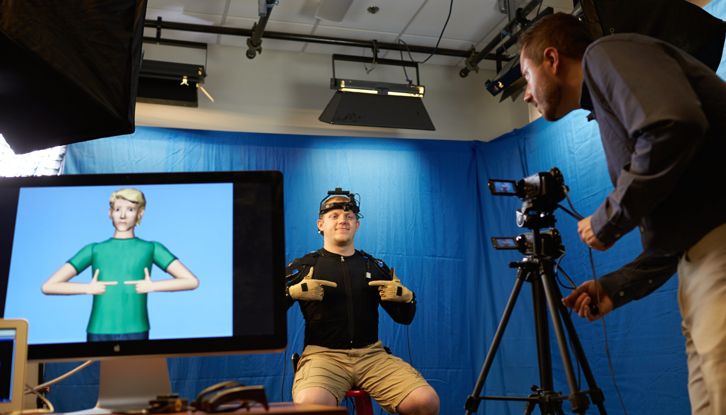 An ASL signer wearing motion-capture equipment.